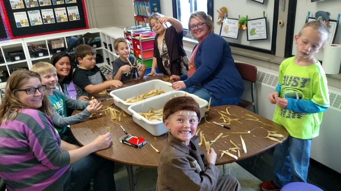 2nd graders doing Pioneer crafts. Thanks to all the volunteers.