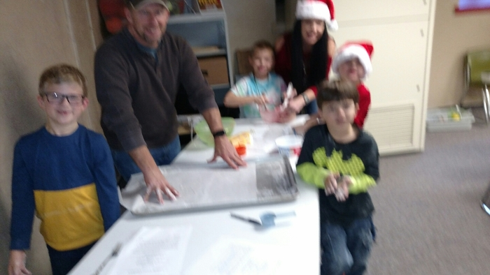MCC 1st graders enjoy making candy cane cookies with parents and grandparents.