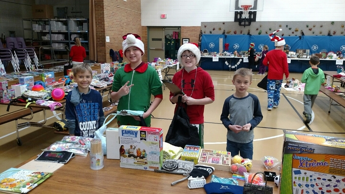 K-2 students participate in the Holiday Sale with 6th grade elf's.