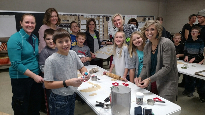 MCC 3rd graders enjoy making cookies with parents and grandparents.