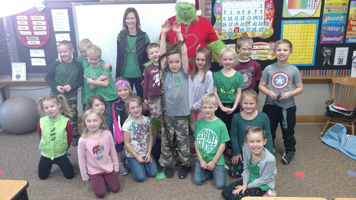 The Grinch visits 1st grade classrooms.